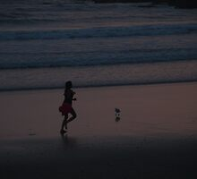Before Sunrise Woolgoolga Beach jogger  by Virginia McGowan