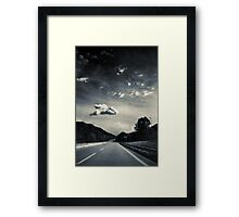 The road and the cloud Framed Print