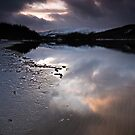 Evening light on a frozen Loch Tummel by Phillip Dove