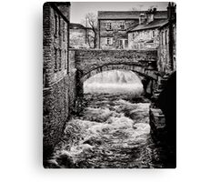Grinding out the stone Canvas Print