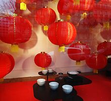 Red lanterns at tea time by Carol Dumousseau