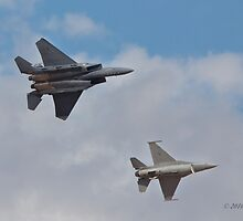 F-15 and F-16 in formation by Chris Heising