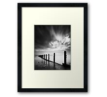 Groynes under a fleeting sky Framed Print