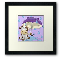 Silly cow under umbrella Framed Print