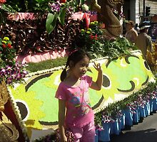 Little Girl Standing in Front of Floral Float. by Mywildscapepics