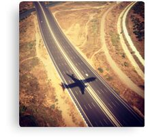 Plane Crossing Canvas Print