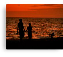 Silhouette of young couple with child Canvas Print