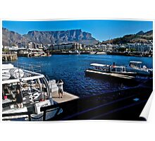 A visitor photographs the V&A Waterfront Poster