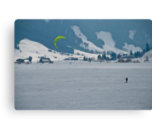 Kiteboarder on a frozen Swiss Alpine lake Canvas Print