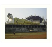 Female Buddha Reclining on the Wall outside a Temple. Art Print