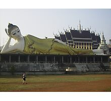Female Buddha Reclining on the Wall outside a Temple. Photographic Print