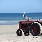 tractor on the beach by Kelsey Henderson