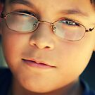 The boy with glasses by Larissa Brea