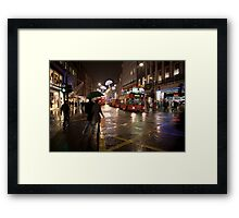Christmas shopping on Oxford Street Framed Print