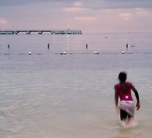 Jamaican young girl swimming during the sunset  by alopezc72