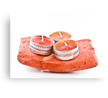 Hand-painted candles on a stone Canvas Print