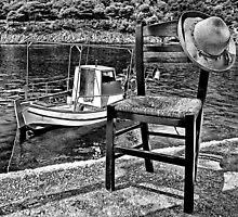 Boat with chair and hat in Kefalonia by Ellamey