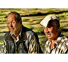 old men basking in the sun. northern india Photographic Print