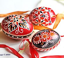 three traditional hand-painted  Czech Easter eggs with geometric designs by pogomcl