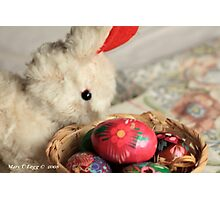 Easter Bunny inspects a basket of hand-painted wooden Czech Easter eggs Photographic Print