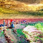 Hikers having lunch in cave by JandeBeer