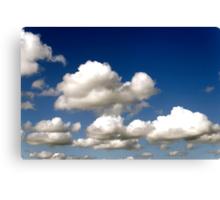 Cumulus clouds, blue sky Canvas Print