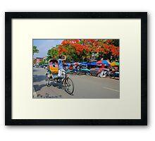 A rickshaw puller became photographers Framed Print