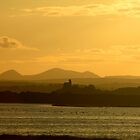 Twilight over Derryveagh mountains - with O'Doherty Castle from Inch Level by George Row