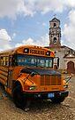 School bus & disused church, Trinidad, Cuba by David Carton