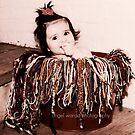 baby in a bucket by Angel Warda
