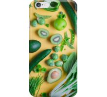 Green food on yellow background iPhone Case/Skin