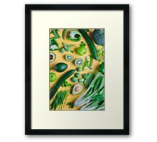 Green food on yellow background Framed Print