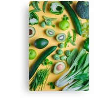 Green food on yellow background Canvas Print
