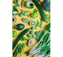 Green food on yellow background Photographic Print