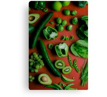 Green food on red Canvas Print