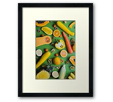 Yellow food on green Framed Print