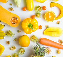 Yellow food on white by Alita  Ong