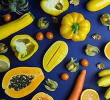 Yellow food on blue by Alita  Ong