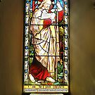 Stained glass at Headley church. by relayer51