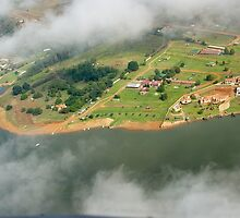 Holiday homes through broken clouds. by Rudi Venter