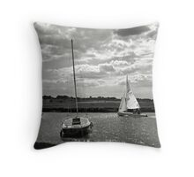 A yacht returns to harbour at Blakeney, Norfolk, UK Throw Pillow