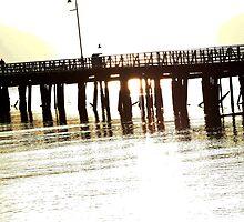 Sun through pier by Saltan