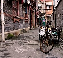Between these walls - Shanghai, China by Norman Repacholi