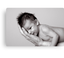 Healthy baby, hiding on fathers arm. Canvas Print