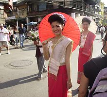 Thai Girl with Red Umbrella in Floral Float Parade. by Mywildscapepics