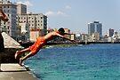 Locals diving off the Malecon, Havana, Cuba by David Carton