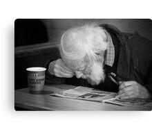 Man reading paper Canvas Print