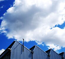 Clouds and metal points to the sky by Mark Malinowski
