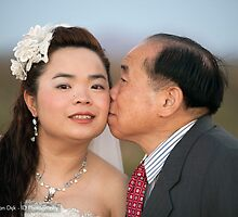 Kiss from dad by idphotography