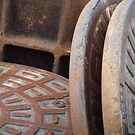 Manhole Covers by Tama Blough